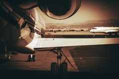 Air Travel Jet Airplane. Air Travel Concept Photo with Compact Jet Airplane. Dark Sepia Color Grading Royalty Free Stock Photography