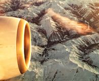 Air travel. With jet engine over mountains, taken with cellphone Stock Image
