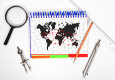 Air travel. Notepad with drawing air travel scheme on the desktop engineer Royalty Free Stock Images