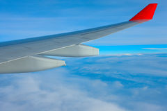 Air travel. Over the ocean of clouds Royalty Free Stock Image