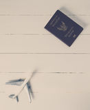 Air travel passport and plane on wooden. Vintage tone Stock Photos