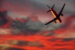 Air travel - plane and sunset Royalty Free Stock Images