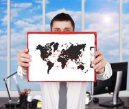 Air travel scheme. Businessman standing in office and holding clipboard with air travel scheme Royalty Free Stock Image