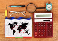 Air travel scheme. Diagram in notebook, red calculator and business object Stock Photo