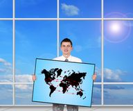 Air travel scheme. Young businessman holding plasma panel with air travel scheme Royalty Free Stock Photography