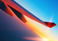 Air travel at sunrise. Airplane wing Royalty Free Stock Photography