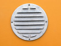 Air vent. On orange wall Royalty Free Stock Photo