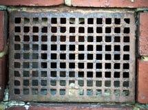 Air vent on brick wall Royalty Free Stock Image