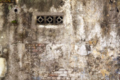 Air vent on a dilapidated wall. An image of an air vent on a dilapidated brick wall stock images