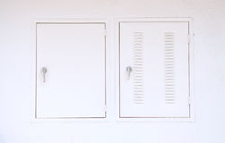 Air vent and window on white wall. Show part of home Stock Images