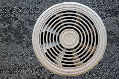Air ventilation duct on a gray surface stock photography