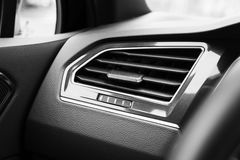 Air ventilation grille with power regulator. Modern car interior detail Stock Photo