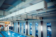 Athletes in the gym. Air ventilation of oxygen in pool and sauna royalty free stock photo
