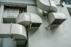 Air ventilation pipes on wall outside building. Air ventilation pipes on wall outside the building stock image