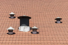 Air vents. Many air vents in a shingle red roof royalty free stock photos