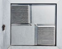 Air vents with lock in electric panel. Air vents with lock in an electric panel royalty free stock photography