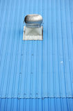 Air vents on top of a blue roof Stock Photo