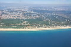 The air view of Costa da Caparica. Almada. Portugal. The air view of Costa da Caparica - a beach in the south municipality of Almada. Almada. Portugal Stock Photos