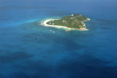 Air view island Seychelles. Flying over a small island in the Seychelles stock images