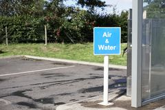 Air and Water sign at petrol station to wash car and inflate car tyres. Uk royalty free stock photos