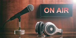 ON AIR written on a black box, headphones and a microphone. 3d illustration. ON AIR written on a black box, headphones and a microphone, brown painted wall Stock Images