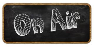 ON AIR written in chalk on blackboard. Wood frame. Illustration Royalty Free Stock Photo