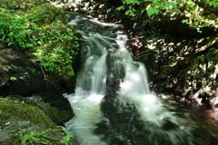 Aira force. Long exposure of a waterfall at Aira force waterfall park in the Lake district in Cumbria stock photo