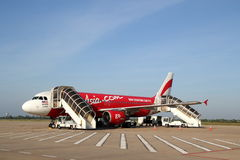 AirAsia Airbus A320. Commercial plane ready for boarding Royalty Free Stock Photos