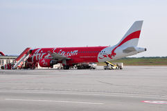 AirAsia Airbus A320. An AirAsia Airbus A320 at Low Cost Carrier Terminal in Kuala Lumpur, Malaysia. AirAsia is a Malaysian low-cost airline named as the world's Royalty Free Stock Photography