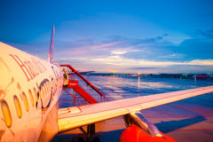 AirAsia Airbus plane at sunset Royalty Free Stock Photo