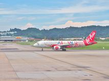 AirAsia Airbus preparing for take-off from Penang International airport in Malaysia. Stock Images