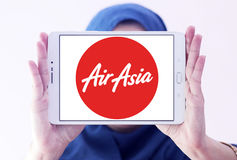 Airasia airlines logo. Logo of airasia airlines on samsung tablet holded by arab muslim woman Royalty Free Stock Photo