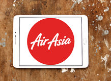 Airasia airlines logo. Logo of airasia airlines on samsung tablet on wooden background Stock Image