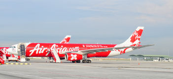 An AirAsia airplane docking at Tan Son Nhat airport in Saigon, Vietnam Stock Photography