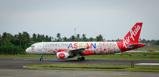 AirAsia airplane on runway at the airport in Kalibo, Philippines Stock Photos