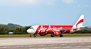 AirAsia airplane on the runway Stock Images