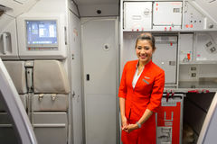 AirAsia crew member. SINGAPORE - NOVEMBER 07, 2015: AirAsia crew member on board of Airbus A320. AirAsia is a Malaysian low-cost airline headquartered near Kuala Royalty Free Stock Image