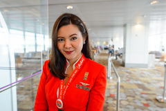 AirAsia crew member. SINGAPORE - NOVEMBER 04, 2015: AirAsia crew member in Changi International Airport. AirAsia is a Malaysian low-cost airline headquartered Royalty Free Stock Image