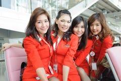 Airasia crew members. BANGKOK - OCT 27: Airasia crew members posing in Bangkok Airport on October 27, 2011 in Bangkok, Thailand. AirAsia Berhad is a Malaysian royalty free stock photography