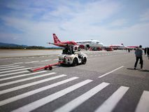Airasia flight. Airasia aircraft at the langkawi airport during the international maritime exhibition of langkawi Royalty Free Stock Photos