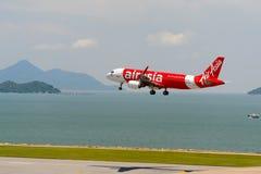AirAsia. HONG KONG - JUNE 04, 2015: Air Asia aircraft landing at Hong Kong airport. AirAsia Berhad is a Malaysian low-cost airline headquartered near Kuala royalty free stock photos