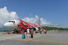 Airasia jet flight. LANGKAWI - MAY 01: Airasia jet flight on May 01, 2014 in Langkawi, Malaysia. AirAsia Berhad is a Malaysian low-cost airline headquartered in Royalty Free Stock Images