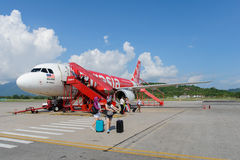 Airasia jet flight. LANGKAWI - MAY 01: Airasia jet flight on May 01, 2014 in Langkawi, Malaysia. AirAsia Berhad is a Malaysian low-cost airline headquartered in Stock Images