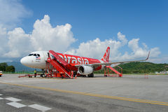 Airasia jet flight. LANGKAWI - MAY 01: Airasia jet flight on May 01, 2014 in Langkawi, Malaysia. AirAsia Berhad is a Malaysian low-cost airline headquartered in Royalty Free Stock Image