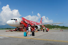 Airasia jet flight. LANGKAWI - MAY 01: Airasia jet flight on May 01, 2014 in Langkawi, Malaysia. AirAsia Berhad is a Malaysian low-cost airline headquartered in Royalty Free Stock Photography