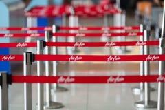 Airasia logo. Printed airasia guardrail in airport, airasia airlines, AirasiaAirline stock photo