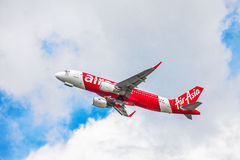 AirAsia plane in sky Royalty Free Stock Images