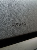 Airbag. Close up of car interior dashboard indicating the passenger airbag location Stock Photos