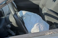 Airbag. Opened airbag after crash, kind through the broken glass Stock Images