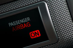 Airbag On. An airbag alert light in a car dashboard, showing airbag is on royalty free stock images